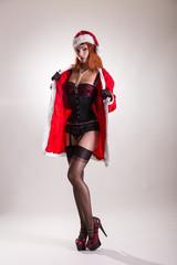 Pinup girl in Santa Claus suit