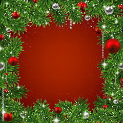 Christmas background with fir branches and balls.