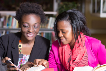 African American Students helping with  assignment