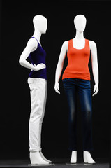 Two mannequin dressed in shirt and trousers
