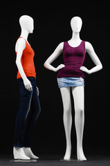 mannequin dressed in shirt and trousers on black background