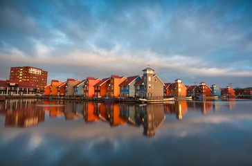 Wall Mural - colorful buildings on water during sunrise, Holland