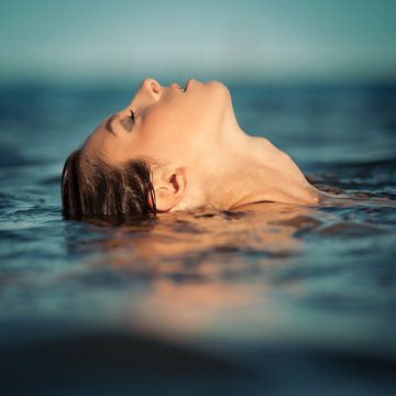 Sensual woman emerging from the water.
