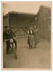 two women and a young man on a motorcycle - circa 1950