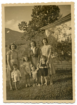 Three young mothers with their children - circa 1950
