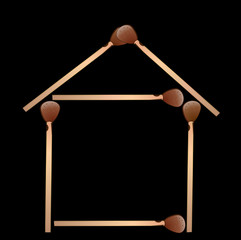 house from matches on a black background