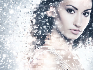 Abstract portrait of a young and beautiful woman in snow