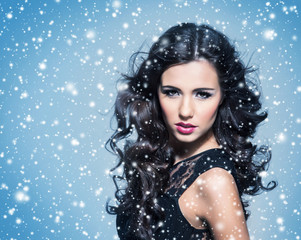 Beauty portrait of a young and attractive woman on the snow