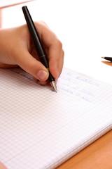 Linke Hand beim Schreiben