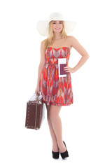 young beautiful blonde in red dress with retro suitcase isolated