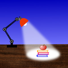 reading-lamp, three books and apple on a table