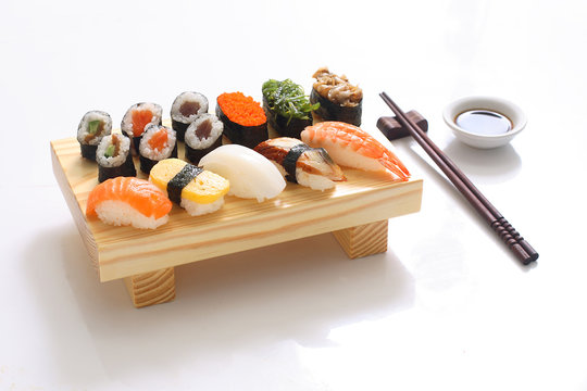 delicious sushi served on wooden board
