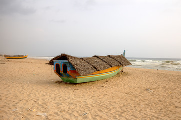 Fishing boat on beach. Kerala, India