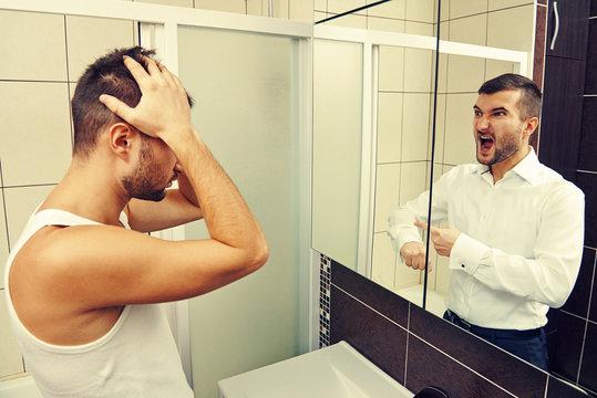 sleepy man looking in the mirror