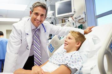 Boy Talking To Male Doctor In Emergency Room