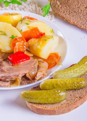 Stew meat with carrots, peppers, onions, potato and pickled cucu