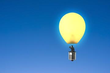 Man taking glowing lamp balloon gazing in sky