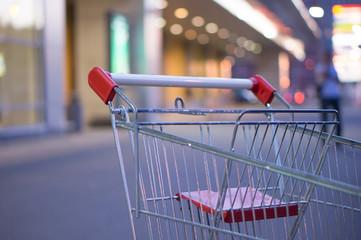 Shopping cart handlebar at entrance of supermarket