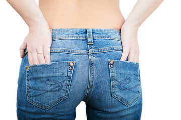 Fit female butt in blue jeans, isolated on white