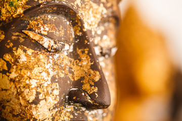 buddha's image with gold leaf