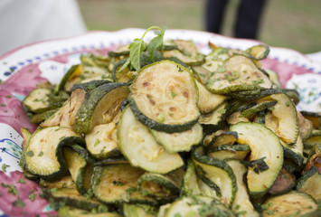 courgette or zuchinni close up in olive oil