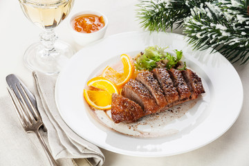 Roasted Duck Breast on New Year's festive table