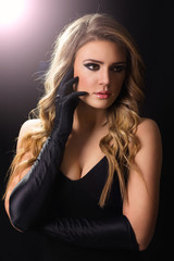 Elegant and glamorous young blonde in black