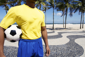 Brazilian Football Player in Uniform Holding Soccer Ball Rio