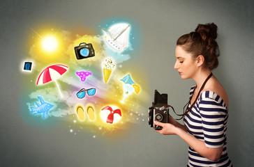 Teenage photographer making photos of holiday painted icons