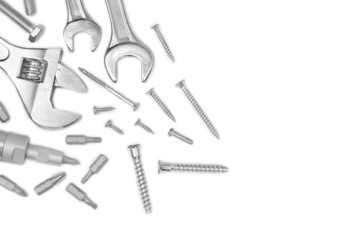 Different tools and screws on white background