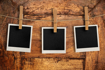 snapshots hanging on a wooden board