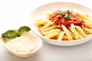 Traditional italian pasta with tomato and peperoni sauce next t