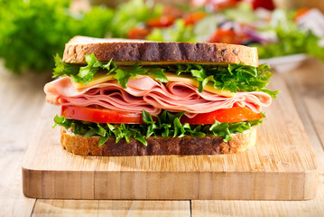 sandwich with bacon and vegetables