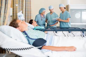 Nurses Discussing Patient's Chart Post Surgery