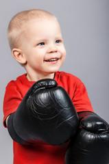 Little boy in boxing gloves