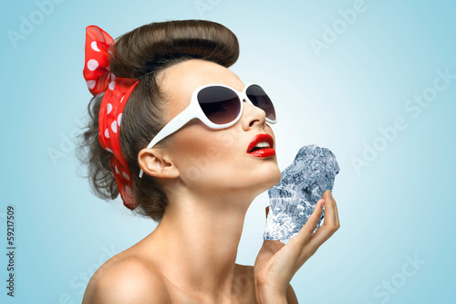 582fb9378 Icy pinup girl   The vintage photo of a glamorous vintage pin-up girl  holding a cool ice cube on her skin for rejuvenation on colorful abstract  cartoon ...