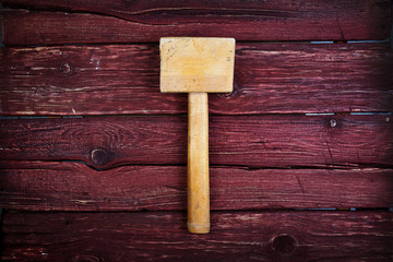 Hammer old vintage wooden made over wood background