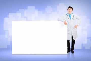 Male doctor with banner