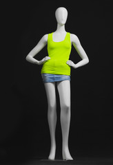 full-length mannequin green dress and shorts –black background