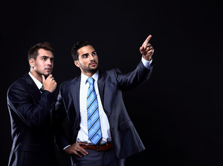 Two young businessman showing empty copyspace