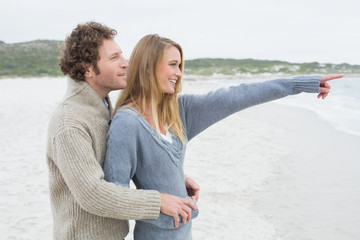 Side view of a relaxed romantic couple at beach