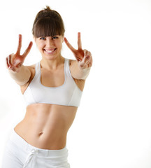 sport young woman with perfect body show victory gesture, fitnes
