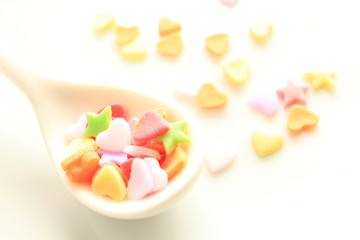 heart shaped candy on spoon for background image