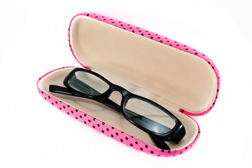 Black Eyeglasses and pink box cover