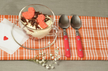Wall Mural - Valentine's Day tiramisu with chocolate in glass cup.