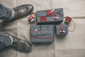 Man boots with valentines gifts box. Hipster ornaments.