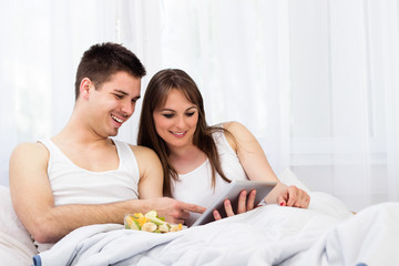 Happy young couple browsing
