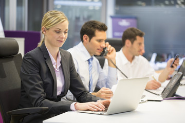 Pretty Businesswoman working on laptop in office