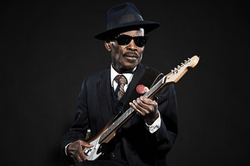 Retro senior afro american blues man. Wearing striped suit with Fotomurales