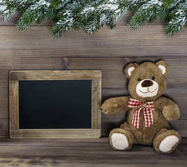 christmas decoration with teddy bear and blackboard